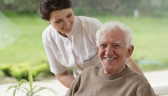 Nurse looking at older man